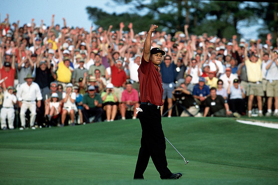 Woods won his second green jacket by two strokes over David Duval.