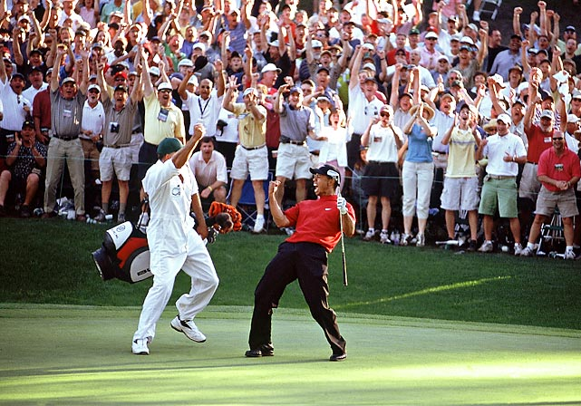 Tiger Woods and caddie Steve Williams celebrated after Woods chipped in for birdie on the 16th hole Sunday at the 2005 Masters.