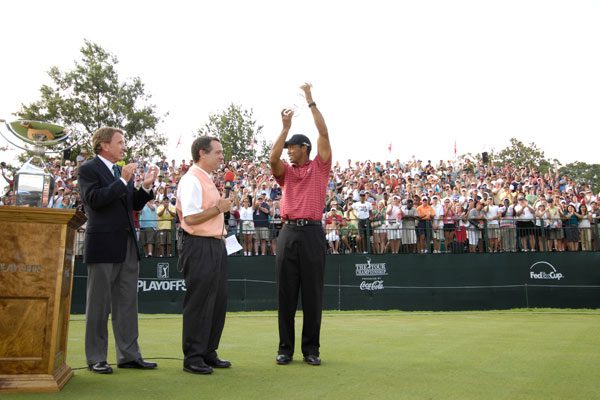 Woods with PGA Tour Commissioner Tim Finchem and NBC's Jimmy Roberts on the 18th green at East Lake after winning the Tour Championship. In his last six tournaments, Woods posted 19 of 24 rounds in the 60s, including the last 11 in a row.