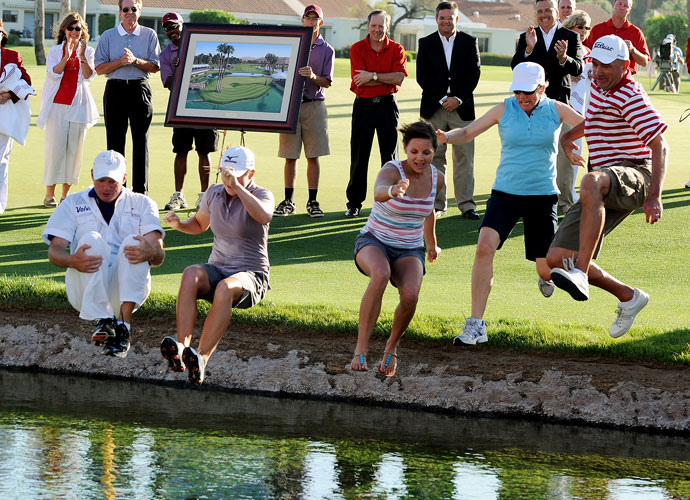 Lewis took the traditional champion's leap into Poppie's Pond after winning the Kraft Nabisco.