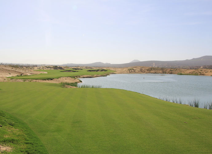 The third hole at El Cardonal, a short par 4 with a water hazard. The course's 18 holes are constructed on part of the 1,500-acre property overlooking the Pacific Ocean.