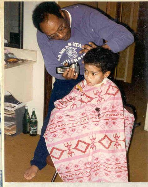 Earl Woods, who played baseball at Kansas State, giving Tiger a trim.
