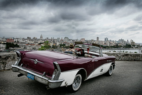 A 1950's Buick on a hillside overlooking Old Havana.