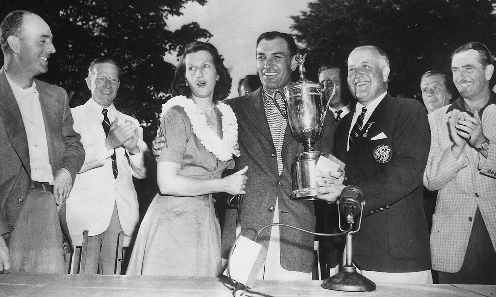 Hogan and his wife, Valerie, with the trophy.