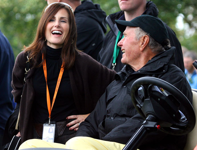 Former U.S. President George Bush speaks with Sonya Toms the wife of United States Ryder Cup team player David Toms during the second day of the 2006 Ryder Cup.