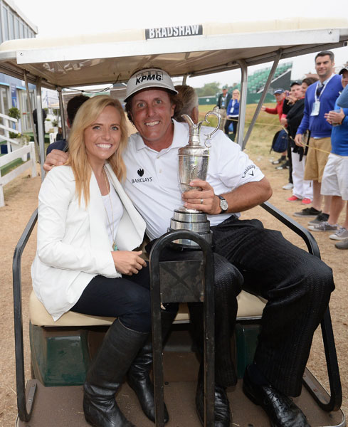 Phil Mickelson holds the Claret Jug with his wife Amy after winning the 142nd Open Championship at Muirfield on July 21, 2013.