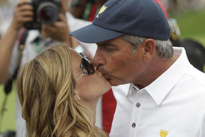 United States team captain Fred Couples with his girlfriend Nadine Moze after the 2013 Presidents Cup golf tournament at Muirfield Village Golf Club.
