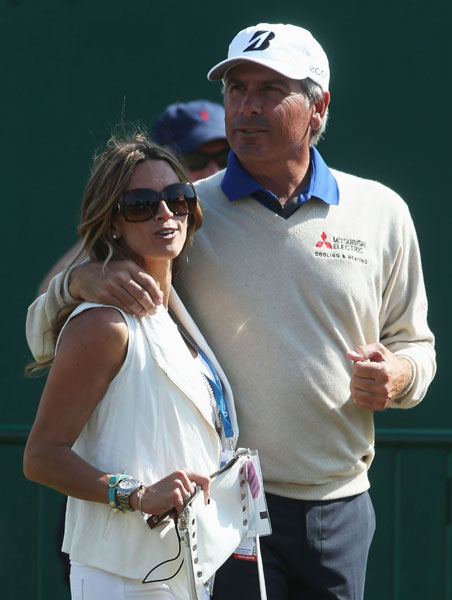 Fred Couples of the United States stands with Nadine Moze ahead of the 142nd Open Championship at Muirfield.