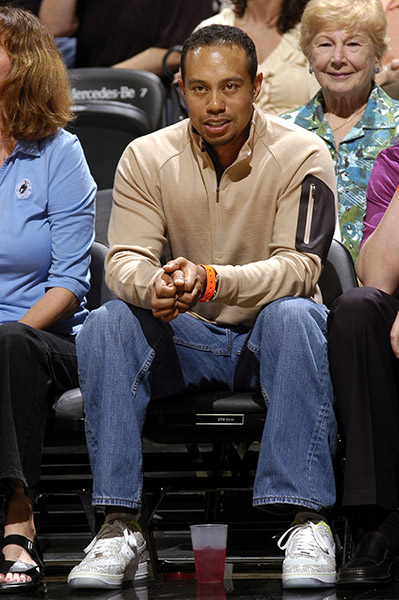 Courtside, Tiger models the classic Mom Jean and Strange-Pocket-Pullover at a 2008 Orlando Magic/Chicago Bulls game.