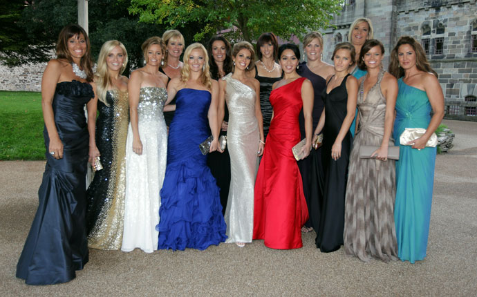 The wives and partners of the 2010 United States Ryder Cup team L-R: Melissa Lehman (Tom Lehman), Amy Mickelson (Phil Mickelson), Tabitha Furyk (Jim Furyk), Robin Love (Davis Love III), Kandi Mahan (Hunter Mahan), Sybil Kuchar (Matt Kuchar), Christina Zimmer (Jeff Overton), Lisa Cink (Stewart Cink), Lisa Pavin (Corey Pavin), Kim Johnson (Zach Johnson), Alexandra Browne (Rickie Fowler), Angie Watson (Bubba Watson), Amanda Caulder (Dustin Johnson), Michelle Mell (Paul Goydos)  pose for a photograph during the 2010 Ryder Cup Dinner at Cardiff Castle on Sept. 29, 2010 in Cardiff, Wales