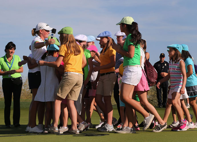 Lewis earned her second victory of the season just two weeks later at the RR Donnelley LPGA Founders Cup at Wildfire Golf Club in Phoenix. She got a group hug from some junior golfers after her win.
