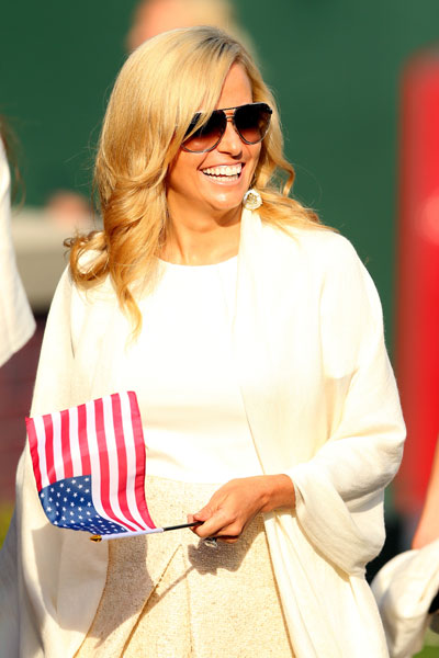 Amy Mickelson acknowledges the applause during the Opening Ceremony for the 39th Ryder Cup at Medinah Country Club.