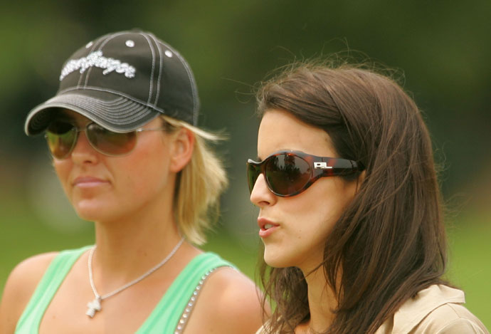 Richelle Baddeley and Diane Donald watch the play of Aaron Baddeley and Luke Donald during the final round of 2007 Players Championship.