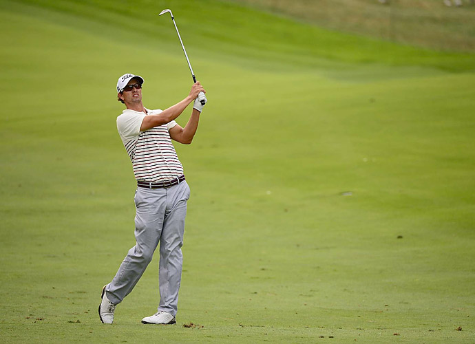Adam Scott got off to a hot start Thursday, finishing tied for the lead at five under.