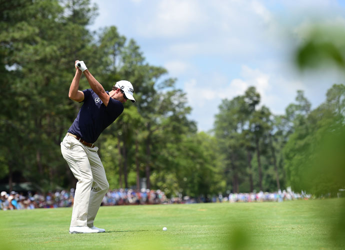 "Adam Scott takes aim during the second round as he gets back to even par. ""We all know that U.S. Opens get very difficult and if I can just somehow put together two really good rounds, maybe slowly but surely I'll creep my way up towards Martin,"" he said."
