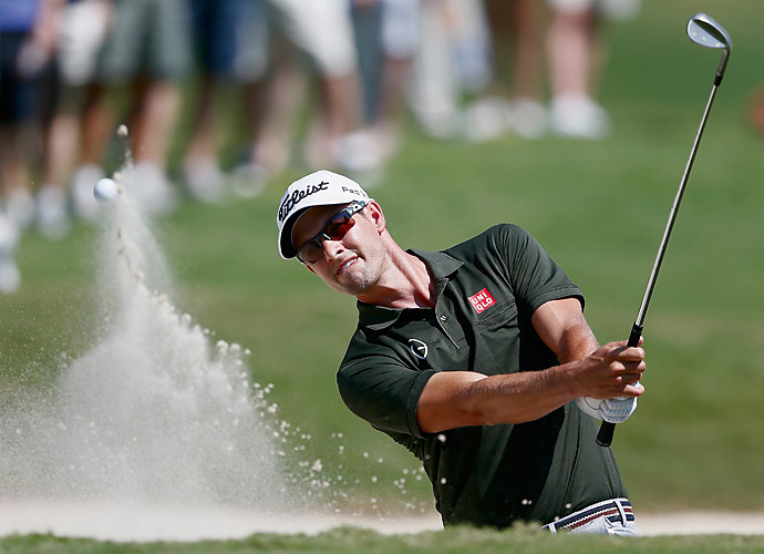 Masters champ Adam Scott is one back after a 65.
