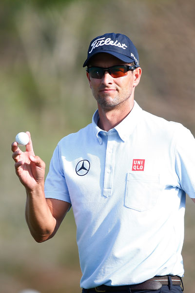 Adam Scott acknowledges the crowd on the 17th green during his second round.