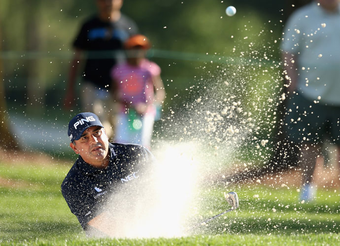 First-round leader Angel Cabrera shot a 69 and maintained a share of the lead with Martin Flores at 9-under.