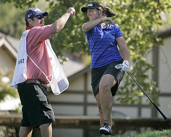 Angela Stanford after chipping in for birdie on No. 10. She finished second at seven under.