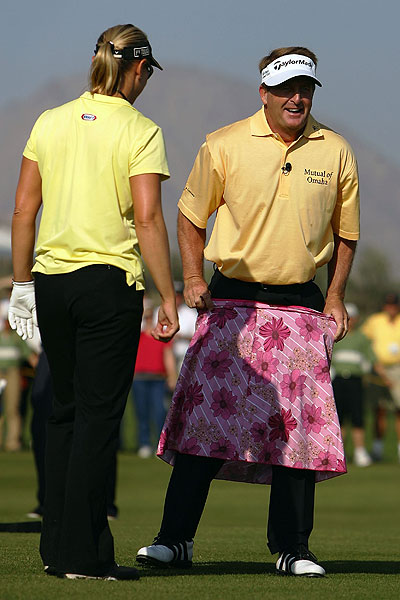 Showing she still remembered how to play with the guys, Sorenstam laughed as Fred Funk put on a skirt after she outdrove him at the 2005 Merrill Lynch Skins Game.