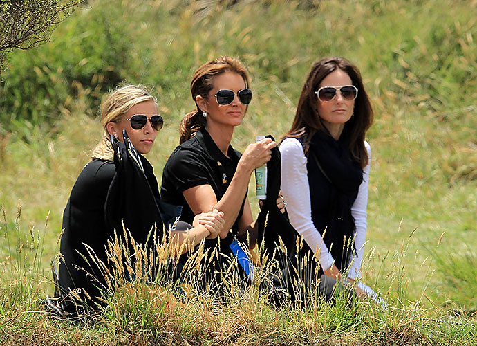 Ashley Widemann, Kirsten Norman, and Sonya Toms watch the action at the 2011 Presidents Cup.