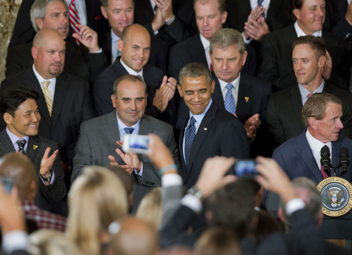 International team member Angel Cabrera and his teammates join President Barack Obama.