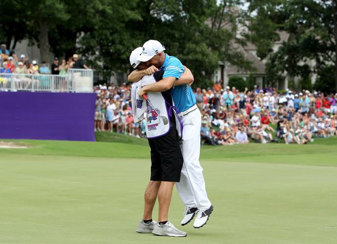 Crane celebrates with his caddie, Joel Stock, after his final putt drops.