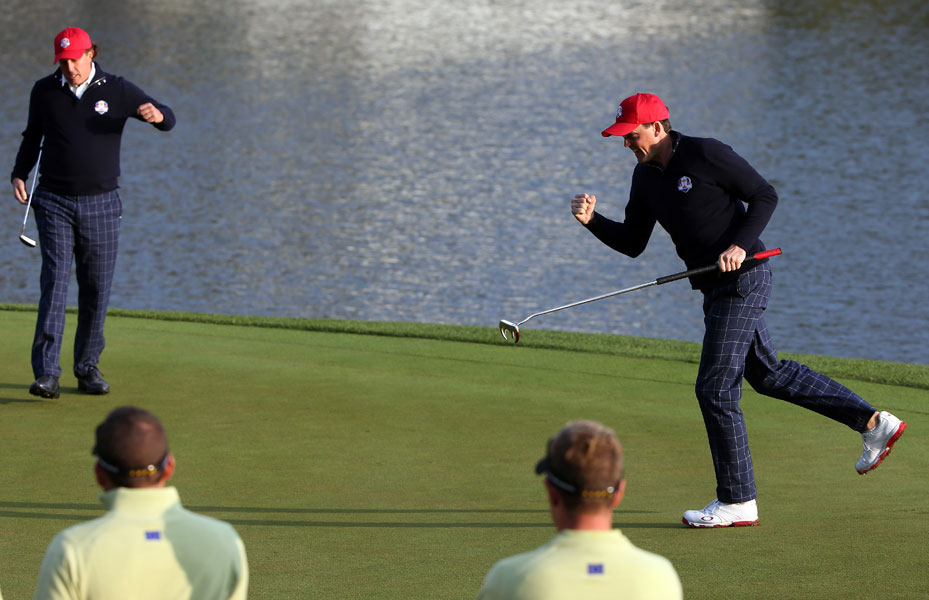 Bradley and Mickelson celebrated a birdie putt on the second green.