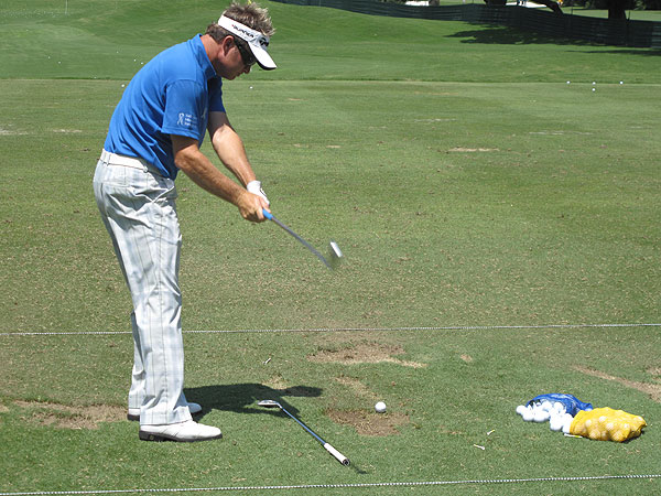 uses one of the simpliest training aids—a club—to help with his alignment.