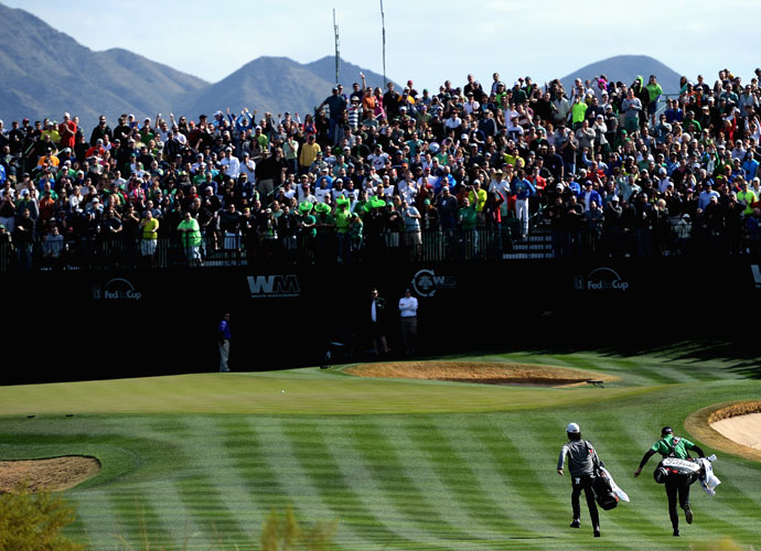 Kevin Na (left) and Brendan Steele race to the 16th green in the third round of Waste Management Phoenix Open. Steele shot 62, the low round of the day. He made nine birdies and no bogies to put himself in contention to win Sunday.