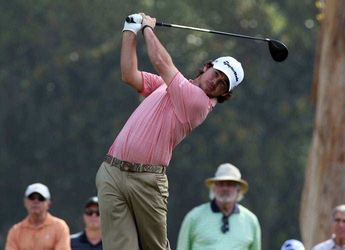 Brian Harman hits his tee shot on the ninth hole. He shot a 4-under 67, one shot behind Dustin Johnson.