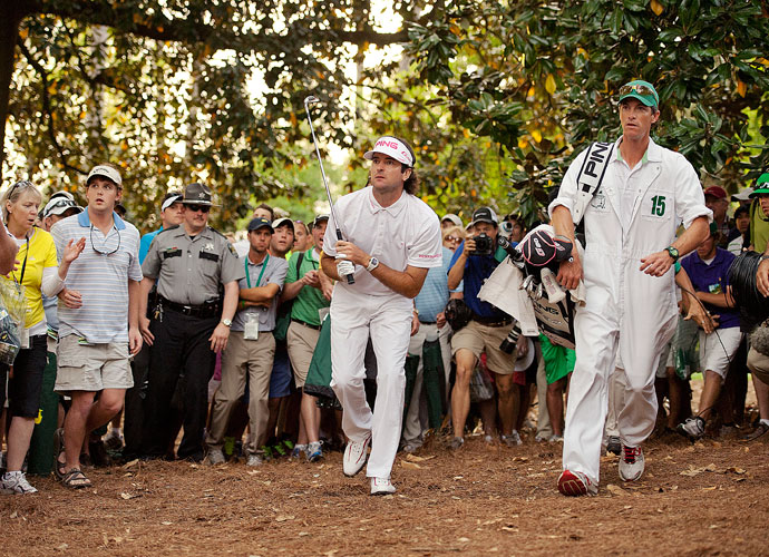 2012 Masters                       Bubba and his caddie, Ted Scott, watch the flight of the ball toward the 10th green. Watson hit a 52-degree gap wedge, hooking it nearly 45 yards to 15 feet. Here's Top 100 Teacher Scott Munroe on how you can play an escape from the pine needles like Bubba.