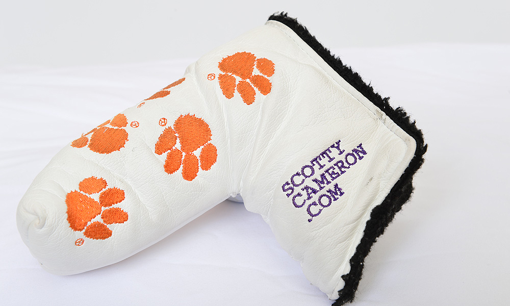 Byrd covers his putter with a Clemson-themed head cover.
