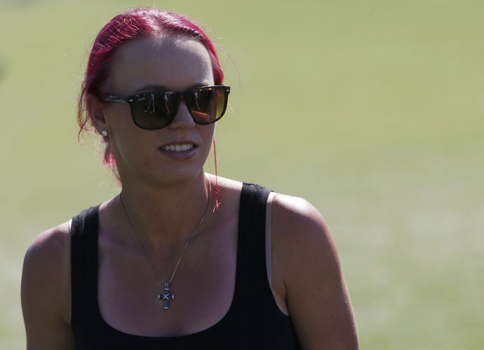 April 10, 2014: Wozniacki's pink hair was a fixture during the open days of the Masters.