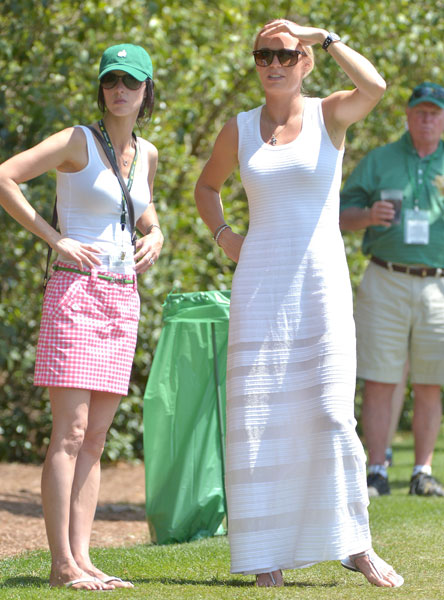 April 13, 2014: Wozniacki watches Rory play the final round of the 2014 Masters. He shot 69.