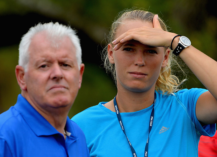 McIlroy's fiancee, Caroline Wozniacki, followed the round with his father, Gerry McIlroy