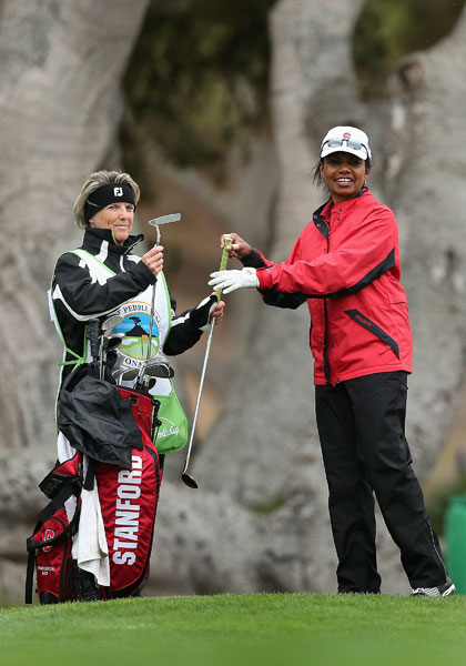 Former Secretary of State Condoleezza Rice takes a club from her caddie on the 12th green during the second round.