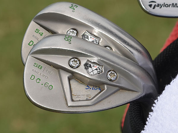 "Clarke has decorative green paintfill added to his TaylorMade TP xFT wedges. The ""D.C. 60"" on both wedges refers to the lowest score the Irishman has shot in competition."