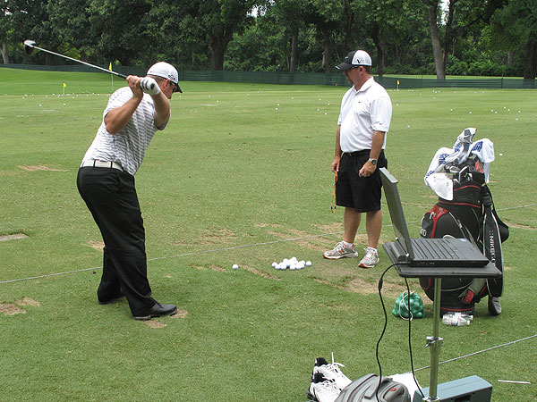practiced with his Nike Victory Red Forged Blade irons and a launch monitor.