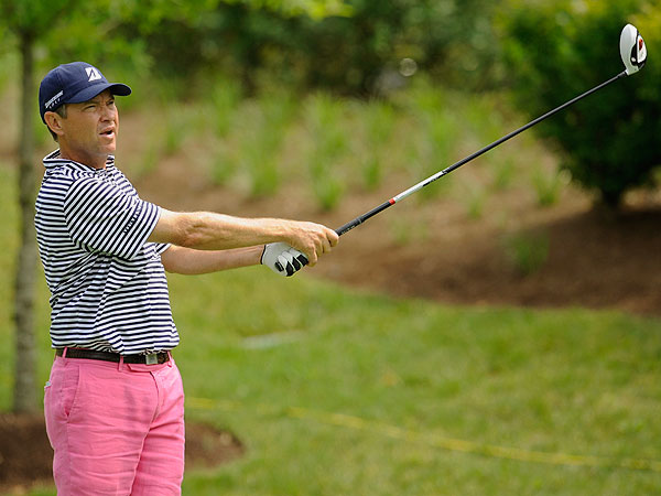 In the opening round, Davis Love showed a sophisticated sense of color, combining a vivid pastel with a bold, offsetting pattern—pink pants with a black-and-white striped golf shirt. That is great golf style.