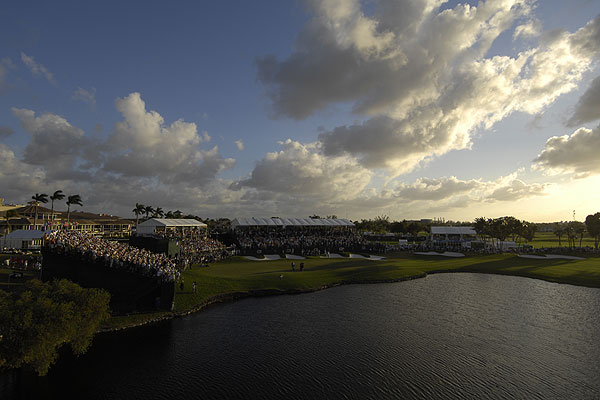 """As the sun set in Miami, Tiger Woods won the WGC-CA Championship at Doral. I mounted a camera on a scoreboard and remotely triggered the shutter. When it was time to take this camera down, I discovered that my assistant, Chuck Cicero, had a fear of heights."""