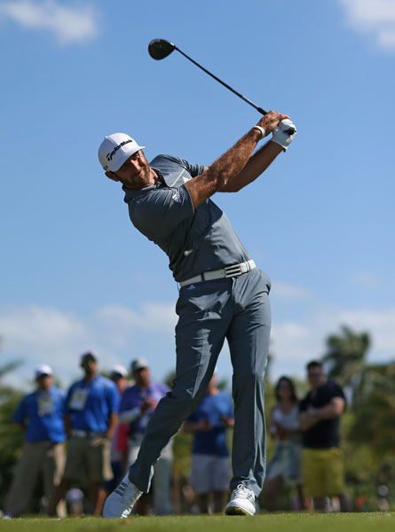 Dustin Johnson hits his tee shot on the ninth hole.