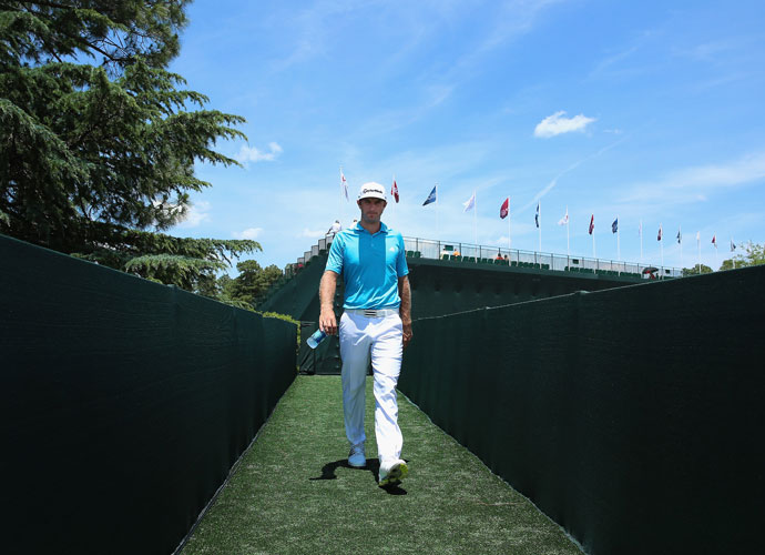 Dustin Johnson makes his way from the practice range back to the clubhouse.