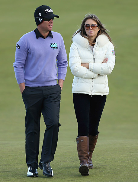 Elizabeth Hurley walked with boyfriend and Australian cricket star Shane Warne in the 2012 Alfred Dunhill Links Championship Pro-Am.