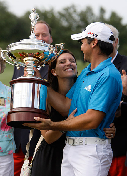 Ellie and Jason hoist the 2010 Byron Nelson Championship trophy.
