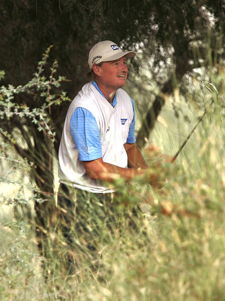 Ernie Els found the tall grass on the 13th hole Friday. The South African shot 72 to finish tied for 13th.