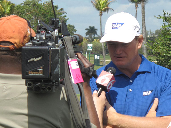 arrived on the range and was swarmed by TV cameras and reporters.