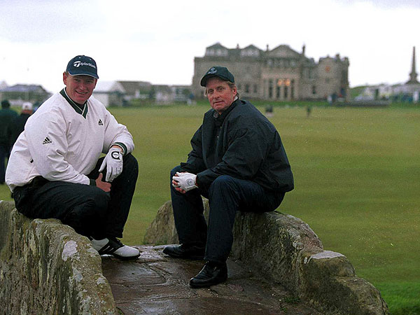Els and movie star Michael Douglas competed together in a pro-am before the 2000 Dunhill Cup. Here, they are shown sitting on the Swilkin Bridge at the Old Course at St. Andrews.