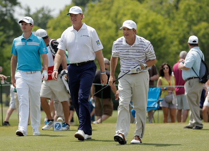 Ernie Els, David Toms and Justin Rose play the eighth hole. Els was -1, a shot outside of the cutline. Toms was -3 and Rose -6.