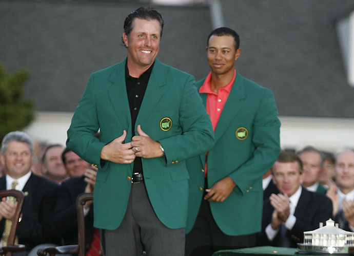 2006                       Tiger Woods wins eight times, including a pair of majors at the British Open and PGA Championship. Woods won an astonishing six-consecutive events beginning in July, two months after the death of his father. Quietly, Phil Mickelson wins his second green jacket in three years as Woods is forced to attend the ceremony and hand another green jacket back to his rival.                                               Business News: Twitter is launched in July.